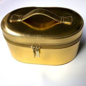 Gold Elizabeth Arden makeup bag